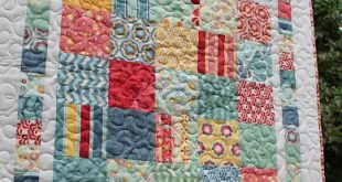 A cute table topper or baby quilt made from one charm pack, and a little yardage...