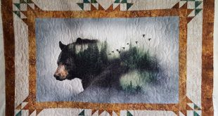 Call of the Wild Bear throw with blowing snow quilt pattern.