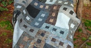 Here is a gray and brown batik twin bed quilt. The grays and browns make a beaut...