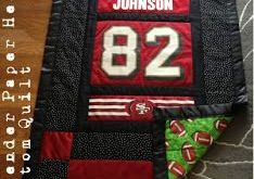 Lavender Paper Hearts: Custom Ordered Quilt. She made it from an old football je...