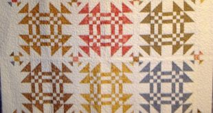 I like the little block made in the sashing. American Vintage Quilts is creative...