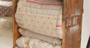Old vintage quilts and linens in a old wood crate..bedroom decor shabby chic ...