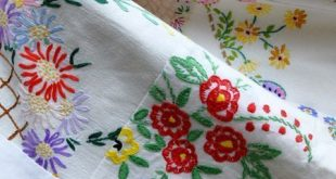 Beautiful quilt made from scraps of vintage embroidery - makes me want to collec...